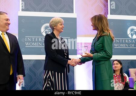 U.S First Lady Melania Trump, right, and Secretary of State Mike Pompeo, left, present Sister Orla Treacy of Ireland with the 2019 International Women of Courage awards at the State Department March 7, 2019 in Washington, DC. - Stock Image