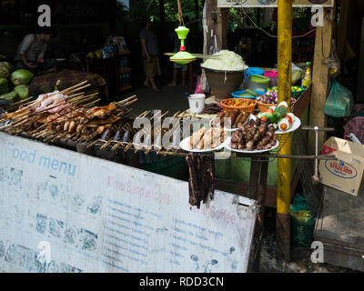Food stall outside entrance to Kuang Si Waterfalls Park Tat Kuang Si Waterfalls near Luang Prabang Laos Asia a very popular tourist attraction - Stock Image