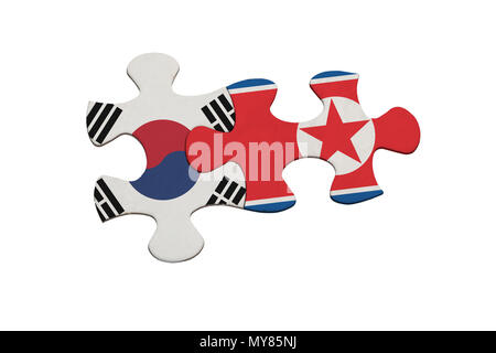 Jigsaw pieces representing the relationship between North Korea and South Korea isolated on white background - Stock Image