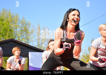 Nis, Serbia - April 20, 2019 Happy teacher and peoples group outdoor Piloxing gathering in park training on sunny day - Stock Image