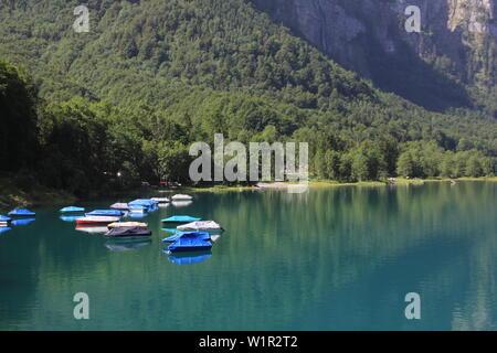 Fishing boats on the shore of Lake Kloental. - Stock Image