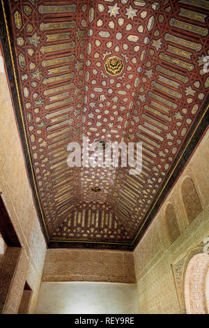 Highly decorative moorish architecture ceiling in the Alhambra Palace Granada Spain - Stock Image