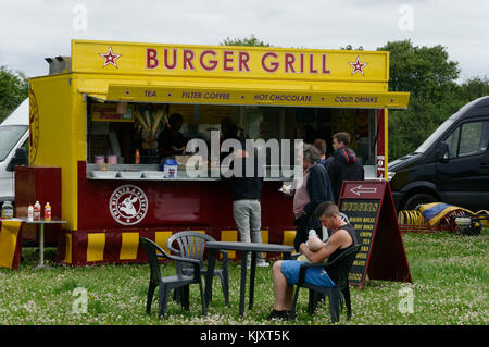 burger bar catering wagon event caterer burgers outside outdoor food wagon trailer van vans bars - Stock Image