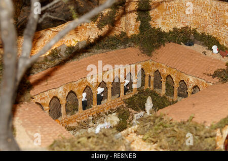 Creche figures and scenes made in Provence.  Here a Cloister figurines scene in la Garde-Freinet (Var) - Stock Image