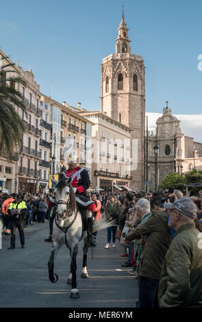 9 April, 2018, A horse rider leads a religious catholic procession from St Marys Cathedral through crowds along the streets of Valencia, Spain. - Stock Image