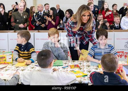 U.S. First Lady Melania Trump meets with children during a Toys for Tots Christmas Event at Joint Base Anacostia-Bolling December 11, 2018 in Washington, DC. Toys for Tots is a Marine Corps Program that collects new unwrapped toys and distribute those toys to less fortunate children at Christmas. - Stock Image