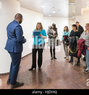 Melville, New York, USA. 24th January 2017. Together We Will Long Island admin (at center in blue tee shirt) SUE - Stock Image