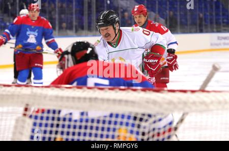 Sochi, Russia. 15th Feb, 2019. Belarus President Alexander Lukashenko, center, takes a shot on goal during a friendly ice hockey match with Russian President Vladimir Putin, #11, at the Shaiba Arena February 15, 2019 in Sochi, Russia. Credit: Planetpix/Alamy Live News - Stock Image