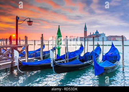 Venice, Italy. Sunrise with Gondolas on Grand Canal, Piazza San Marco, Adriatic Sea. - Stock Image