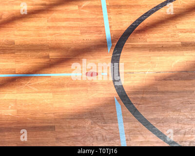 Playfield lines painted on renewal gymnasium wooden floor. Inside athletic playground - Stock Image
