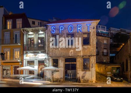 Vila Nova de Gaia at night with illuminated signs, sports restaurant. - Stock Image