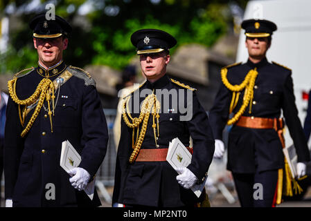 Soldiers leaving the Royal Wedding of Meghan Markle and Prince Harry at Windsor Castle carrying order of service programmes. In uniform. Officers - Stock Image