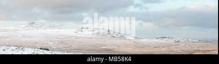 Panoramic view of snow covered tors Dartmoor national park Devon Uk - Stock Image
