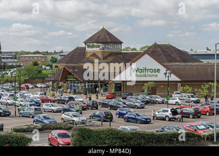 A large Waitrose Food and Home Superstore with car park in front, Rushden, Northamptonshire, UK - Stock Image
