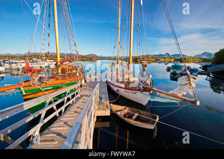 Wooden sailing ships are moored in the small boat harbor in Ringstad on island Langøya (Vesterålen) in - Stock Image