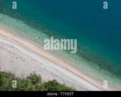Empty paradise beach and calm blue sea in Croatia - Stock Image