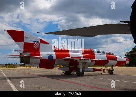 MiG21 MiG-21 MiG 21 UMD Croatian Air Force display fighter with white red squares apron 165 concrete apron parked - Stock Image