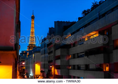 Twilight view of the Eiffel tower from Rue St. Dominique, Paris, France.  It is the world famous wrought-iron lattice tower that is the most famous la - Stock Image