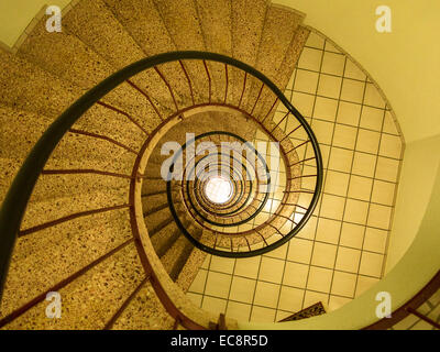 Looking down a stairwell in a block of flats - Stock Image