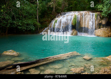 Wang Matcha, the second tier of Erawan Waterfall in Kanchanaburi Province, Thailand, with fish swiming in the clear water. - Stock Image