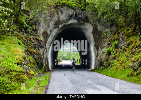 Wet weather cycling in Norway - Stock Image