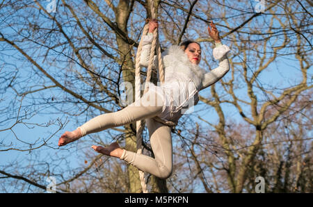Female acrobat in woodland outdoor theatre performance by Whispering Wood Folk at Hodsock Priory, Nottinghamshire, - Stock Image