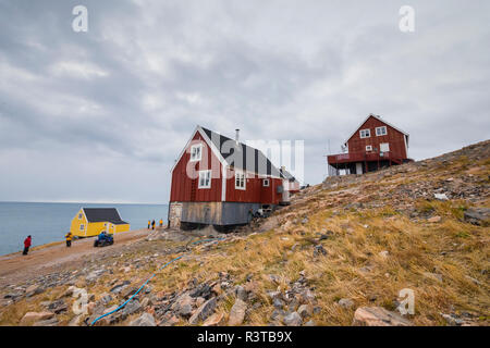 Greenland. Scoresby Sund. Ittoqqortoormiit. Colorful houses perched on the hillside. - Stock Image
