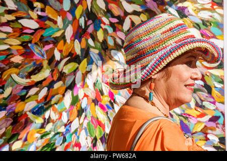 Fort Lauderdale Ft. Florida Las Olas Boulevard Las Olas Art Fair festival street fair community event art painting woman hat loo - Stock Image