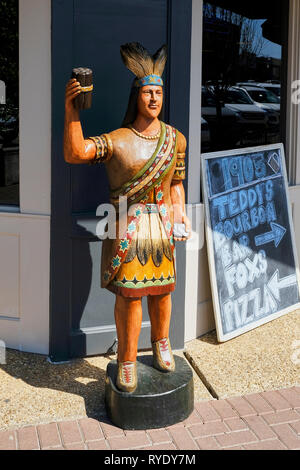 Cigar store indian or wooden indian stands in front of  a business in Prattville Alabama, USA. - Stock Image