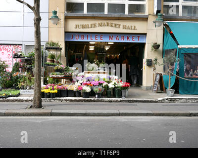 Florist outside the Jubilee Market Hall, Covent Garden, London UK - Stock Image