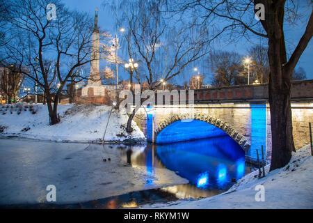 Winter evening in the park in Riga. - Stock Image