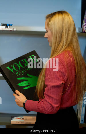 """Dundee, Tayside, Scotland, UK. 25th September, 2018. A young woman Rhianna Martin pays her first visit to the stunning new V&A building reading """"Vogue The Jewellery"""" Book inside the Museum in Dundee, UK. Credits: Dundee Photographics / Alamy Live News - Stock Image"""