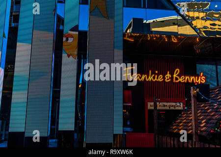 An illuminated artwork in Leicester with a restaurant behind. - Stock Image
