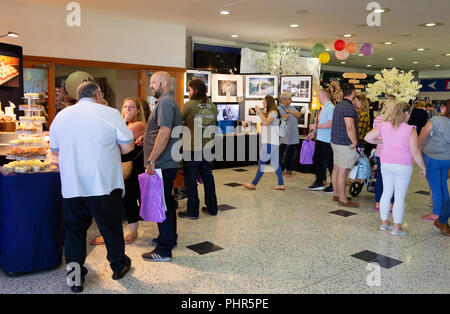 People shopping and choosing wedding preparations at a Wedding Fair, Newmarket, Suffolk UK - Stock Image