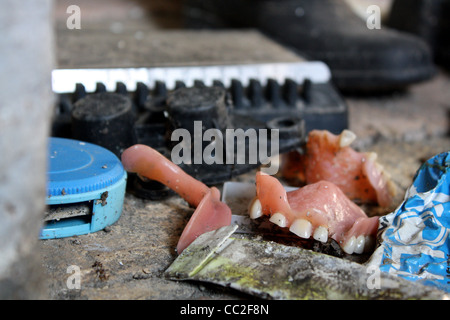 Dentures found on the floor in an abandoned house in Italy - Stock Image