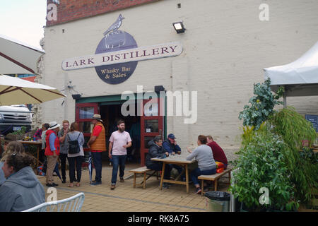 Crowd in garden area outside Lark Distillery whisky bar, Hobart, Tasmania, Australia. No PR or MR - Stock Image