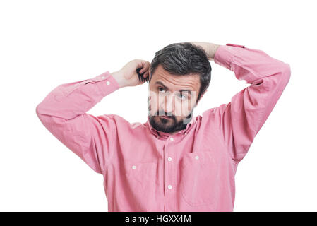 Handsome young beard man combing his hair - Stock Image