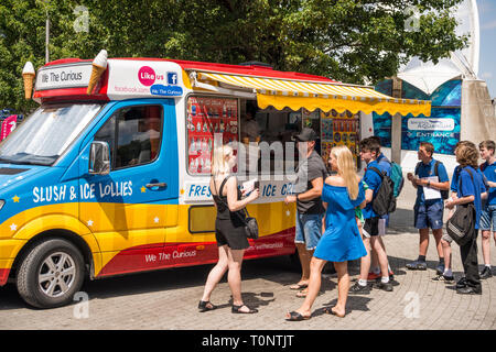 People queueing for ice cream on hot summer day, Bristol, UK - Stock Image
