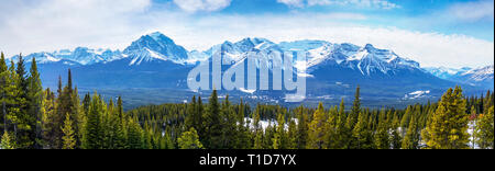 Sweeping vista of the snow-capped mountain landscape showing Mount Victoria glacier of the Canadian Rockies near Banff National Park in Alberta, Canad - Stock Image