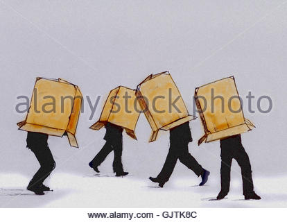 Businessmen walking cardboard box covering head - Stock Image