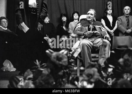 Chairing the bard ceremony on stage at small eisteddfod in village hall Talsarnau Gwynedd Wales UK - Stock Image