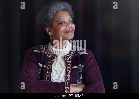 Portrait confident, satisfied senior woman looking away - Stock Image