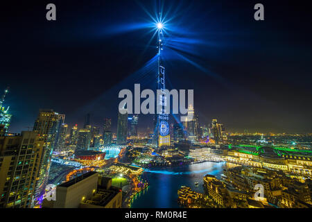 The New Year celebrations in Dubai as the world's tallest building cascades light across the city. - Stock Image