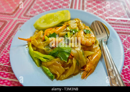 Prawns and other seafood with flat noodles, Fresh Food Market, Krabi town, Thailand - Stock Image