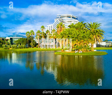 Crown Casino and Crown Metropol hotel surrounded by palm trees and a lake. Burswood, WA - Stock Image