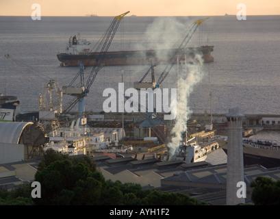 Dusk over Shipyard, Bay of Gibraltar, Tankers, shipyard shipyards sunset sunsets dusk ship ships shipping tanker tankers - Stock Image