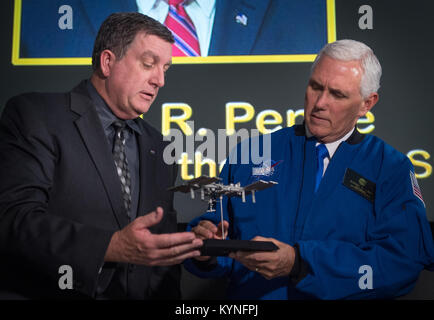 NASA manager of the International Space Station (ISS) Program Kirk Shireman, left, presents Vice President Mike - Stock Image