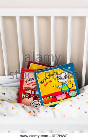 Poznan, Poland - November 8, 2018: Polish Kicia Kocia story about cooking. Book laying in a baby bed. - Stock Image