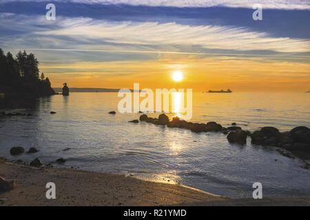 Beautiful Sunset across Burrard Strait from Stanley Park Seawall in Vancouver British Columbia Canada - Stock Image