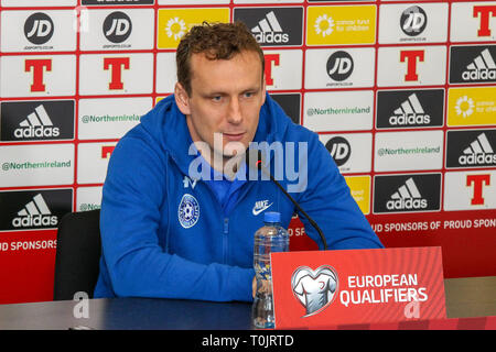 Windsor Park, Belfast, Northern Ireland, UK. 20 March 2019. The Estonian press-call before tomorrow night's Euro 2020 qualifying game in Belfast. Konstantin Vassiljev speaking at the press-call. Credit: David Hunter/Alamy Live News. - Stock Image